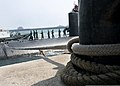 U.S. Sailors aboard the attack submarine USS Cheyenne (SSN 773) pull a mooring line as the sub arrives in Busan, South Korea, March 20, 2013 130320-N-TB410-294.jpg