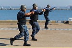 U.S. Sailors assigned to the aircraft carrier USS George H.W. Bush (CVN 77) conduct security drills during a force protection exercise Oct. 2, 2013, at Naval Station Norfolk, Va 131002-N-MW819-069.jpg