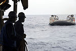 U.S. Sailors watch as a landing craft, air cushion (LCAC) is towed into the well deck of the dock landing ship USS Germantown (LSD 42) in the Pacific Ocean during an emergency rescue exercise June 18, 2013 130618-N-KL846-060.jpg
