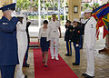 U.S. Service members salute as Norwegian Defense Minister Ine Eriksen Søreide arrives for Rim of the Pacific (RIMPAC) 2014 at Camp H.M. Smith, Hawaii, June 30, 2014 140630-N-DX698-044.jpg