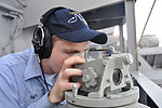 USS Nimitz docks in Bahrain DVIDS216547.jpg