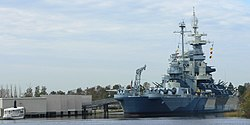 The USS North Carolina Battleship Memorial, seen from downtown Wilmington, looking across the mouth of the Cape Fear.