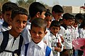 US Army 53033 TAJI, Iraq - Students of the Twin Schools wait for the official opening of the schools here, Oct. 12. The Twin Schools will provide and education to over 1200 children in a small village north of Bagh.jpg