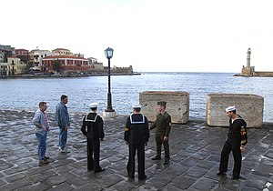 Shore patrol - Shore patrol speaks with sailors in Crete, 2003