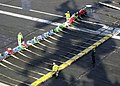 US Navy 030625-N-0119G-002 Sailors assigned to the air department lay out the barricade.jpg