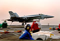 US Navy 031026-N-4336G-055 An F-A-18E Super Hornet assigned to the Eagles of Strike Fighter Squadron One One Five (VFA-115) lands aboard USS John C. Stennis (CVN 74).jpg