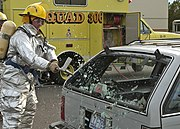 US Navy 040729-N-1407C-006 A Mass Causalities Drill was conducted aboard Naval Air Station Oceana during training exercises. Firefighter-Emergency Medical Technical (EMT) Greg Tetro breaks the rear glass of an automobile to res