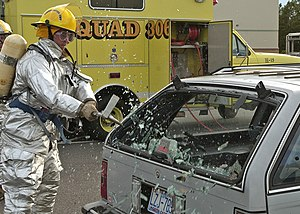 Naval Air Station Oceana - A Mass Casualties Drill was conducted aboard Naval Air Station Oceana during training exercises. Firefighter/Emergency Medical Technical (EMT) Greg Tetro breaks the rear glass of an automobile to rescue a trapped victim