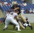 US Navy 040911-N-9693M-015 U.S. Naval Academy Midshipman 1st Class Frank Divis gains yardage against the Northeastern Huskies' EJ Jackson.jpg