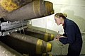 US Navy 050119-N-5464G-021 Airman Candice Bell, from West Forks, Maine, catalogs and inventories a palette of MK-84, 2000-pound penetrator bombs as they enter one of USS Kitty Hawk (CV 63) magazines.jpg