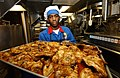 US Navy 050416-N-5526M-003 Culinary Specialist David Wade, pulls chicken out of the oven for lunch aboard Arleigh Burke class guided-missile destroyer USS Mustin (DDG-89)..jpg
