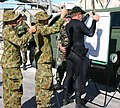 US Navy 050618-N-6551H-031 Members of Australian Defense Force Clearance Diver Team Four demonstrate how divers are to line up.jpg