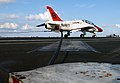US Navy 050626-N-5345W-115 A T-45A Goshawk trainer aircraft, assigned to Training Air Wing Two (TW-2), makes an arrested landing on the flight deck aboard the Nimitz-class aircraft carrier USS Harry S. Truman (CVN 75).jpg