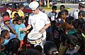 US Navy 050825-N-3455P-012 Engineman Fireman Andy Davis plays the drums for local children in Majuro, Marshall Islands after participating in a parade.jpg