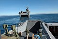 US Navy 051205-N-7365L-110 A Landing Craft, Utility (LCU) backs out of the well deck of the amphibious assault ship USS Peleliu (LHA 5).jpg