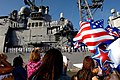 US Navy 060109-N-9643K-007 Family members wait on the pier as the guided missile cruiser USS Chosin (CG 65) returns.jpg