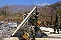 US Navy 060121-F-4462M-032 U.S. Navy Seabees assigned to Naval Mobile Construction Battalion Four (NMCB-4)) build a temporary school in the mountains near Muzaffarabad, Pakistan.jpg