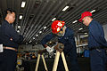 US Navy 061111-N-4207M-055 A member of USS Essex (LHD 2) Repair Locker 2F pipe patching team, Postal Clerk Seaman Apprentice Tavon A. Ferguson, patches a pipe with an Emergency Water Activated Repair Patch.jpg