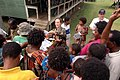US Navy 070808-N-9421C-143 Lt. Lydia Battey distributes handouts explaining the symptoms of tuberculosis to local residents at Bunabun Health Center in Madang, Papua New Guinea.jpg