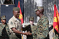 US Navy 071213-M-1341G-044 Sergeant Major Carlton W. Kent presents Sergeant Goumandakoye Ousmane with 9th Communications Battalion, one of the 16th Sergeant Major of the Marine Corps challenge coin.jpg