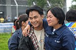 US Navy 080627-N-3659B-059 Storekeeper Seaman Grace Geroche, a native of Iloilo and Sailor assigned to the Nimitz-class aircraft carrier USS Ronald Reagan (CVN 76), embraces her brother upon arriving as part of U.S. Navy relief.jpg
