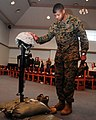 US Navy 090220-M-5402D-009 Master Chief Shannon S. Williamson gives a moment of silence to Staff Sgt. Daniel L. Hansen during his memorial service at the Marine Corps Air Station Iwakuni chapel.jpg