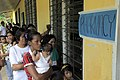 US Navy 090420-A-0759M-019 Residents stand in line to receive medication at Umiray Elementary School during a medical civic action project supporting Balikatan 2009.jpg
