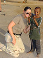 US Navy 090924-N-XXXXC-604 Electronic's Technician 2nd Class Jodi Keller shares a moment she captured with a boy from the Centre le Nationale Protection de Juvenile.jpg