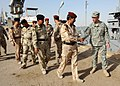 US Navy 090929-N-7088A-161 Cmdr. Chip Wrye, executive officer of Iraqi Training and Advisory Mission-Navy greets members of the Iraqi army and navy as they arrive.jpg