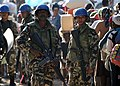 US Navy 100220-N-5961C-005 U.N. peacekeepers from Nepal stand by as Haitian citizens wait for rice at a distribution point in Kenscoff, Haiti.jpg