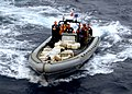 US Navy 100304-N-7058E-037 Sailors and Coast Guardsmen from USS Freedom (LCS 1) transport bales of cocaine seized from a go-fast small boat in the southern Caribbean Sea.jpg