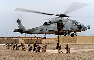 US Navy 100427-N-0879R-998 Iraqi Special Operations Forces soldiers set a perimeter after fast-roping insertion training.jpg