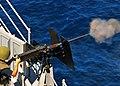 US Navy 100530-N-7643B-232 Cryptologic Technician (Technical) Seaman Nicholas Killion fires the .50-caliber machine gun at a target as part of a surface gunnery exercise aboard USS Tortuga (LSD 46).jpg