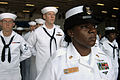 US Navy 100715-N-1281L-133 Master Chief Culinary Specialist Marilyn Kennard leads the honor platoon during a burial at sea aboard the amphibious assault ship USS Makin Island (LHD 8).jpg