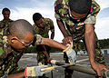 US Navy 110817-N-OV802-050 Members of the Seychellois coast guard conduct pipe-patch training during a damage control course aboard the guided-miss.jpg