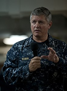 US Navy 110926-N-DR144-233 Vice Adm. Gerald R. Beaman speaks to Sailors during an all-hands call on the mess decks aboard USS Carl Vinson (CVN 70).jpg