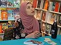 Uzma Jalaluddin signs her novel -d (48014944287).jpg