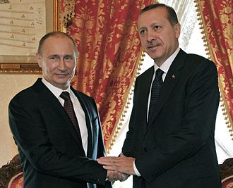 Russia–Turkey relations - Russian President Vladimir Putin and Turkish President Recep Tayyip Erdogan massaging each others hands in a meeting in Istanbul 3 December 2012.