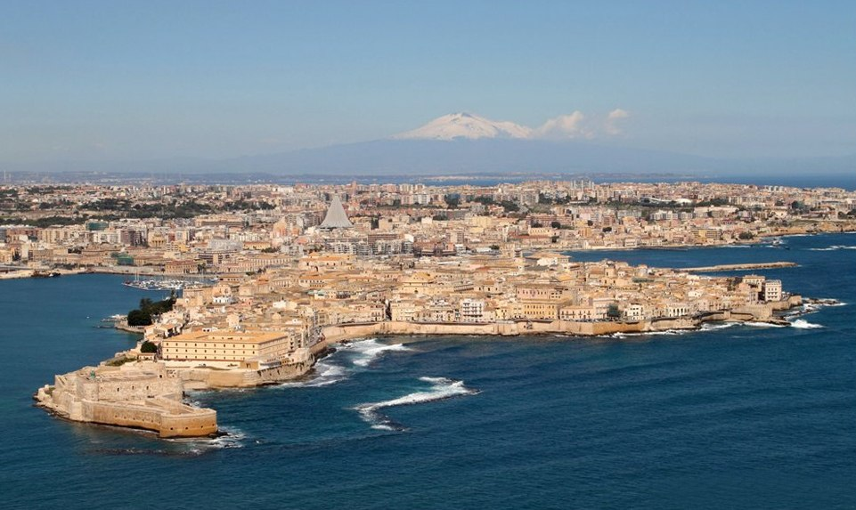 Ortygia island, where Syracuse was founded in ancient Greek times. Mount Etna is visible in the distance.
