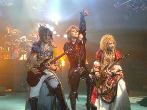Visual kei - Versailles performing in 2010, wearing costumes similar to the French Rococo style.