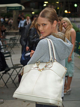Handbag - Model at New York Fashion Week showing a Louis Vuitton handbag.