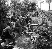 Vickers machine-guns fire in support of troops crossing the Maas-Schelde Canal