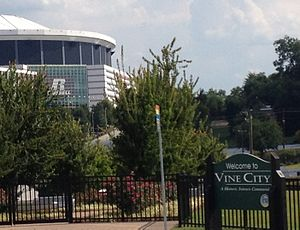 English Avenue and Vine City - Vine City sign with Georgia Dome in background
