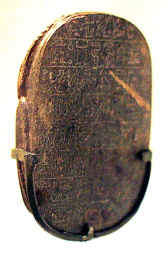 The lion hunts of Amenhotep III during the first ten years of his reign - (Example scarab bottom):Medium to moderate size scarab, with horizontal text. (Text always reads into the faces of animals, right-to-left, this scarab.)