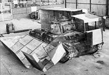 A tank with its 'Sunshield' camouflage half open in workshops near Cairo