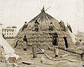 Wichita Indian group building their lodge for the Department of Anthropology exhibit at the 1904 World's Fair.jpg