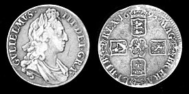 "Silver crown coin of William III, dated 1695. The Latin inscription is (obverse) GVLIELMVS III DEI GRA[TIA] (reverse) MAG[NAE] BR[ITANNIAE], FRA[NCIAE], ET HIB[ERNIAE] REX 1695. English: ""William III, By the grace of God, King of Great Britain, France, and Ireland, 1695."" The reverse shows the arms, clockwise from top, of England, Scotland, France, and Ireland, centered on William's personal arms of the House of Orange-Nassau."