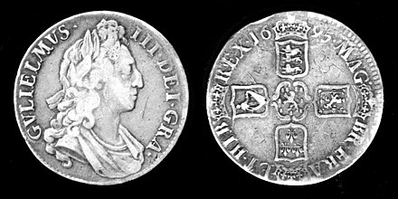 "Silver Crown coin, 1695. The Latin inscription is (obverse) GVLIELMVS III DEI GRA[TIA] (reverse) MAG[NAE] BR[ITANNIAE], FRA[NCIAE], ET HIB[ERNIAE] REX 1695. English: ""William III, By the grace of God, King of Great Britain, France, and Ireland, 1695."" The reverse shows the arms, clockwise from top, of England, Scotland, France, and Ireland, centred on William's personal arms of the House of Orange-Nassau. William III Silver Coin.jpg"