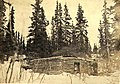 William and Mabel Meed in front of their log cabin at lower end of Lake Laberge, Yukon Territory, spring 1902 (MEED 142).jpg