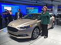With the new Ford Fusion hybrid--assembled in Flat Rock--at the North American International Auto Show. (23694231133).jpg